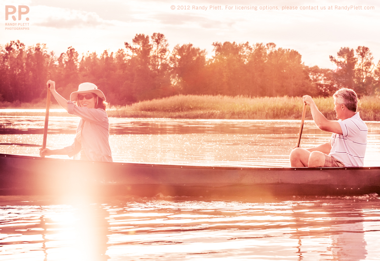 Mature Couple Outdoors in a Canoe